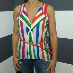 """💋TREND ALERT💋""""Playful in stripes""""top NWOT 💋 TREND ALERT 💋 💋Strips are all the rage for spring/summer!!?💋  Brand new no tags Playful in pinstripes top. Pair with jeans, a skirt or shorts and heels for a fabulous outfit!  100% rayon Belt included Length to shortest part approx 24"""", length to points on side approx 29"""" Bust approx 18.5"""" side to side laid flat  💋Price is firm unless bundled 💋No trades     Tops Blouses"""