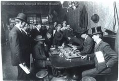 Wyatt Earp dealing at one of the Oriental Saloon's faro tables. To his right, Doc Holliday. Wyatt Earp became manager of the Oriental Saloon, entitling him to receive one-quarter interest in its faro concession. Tombstone, Arizona  January 1881