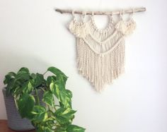 ABOUT THIS MACRAME WALL HANGING  MAJESTIC Frilly tassels and copper piping make Majestic a little beauty. This wall hanging measures roughly 55cm x 80cm. *Since Majestic is made to order, your end product might differ slightly from the images in the listing (thickness/texture of driftwood for example). If you would like to choose your driftwood from some available options, please let me know and Ill send you some photos. *Please note the processing time on this piece is 6-8 weeks due to ...