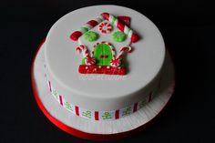 """A tiny 4"""" rich fruit cake with marzipan and fondant icing for a Christmas gift. All decorations in fondant and liberally covered in twinkle ..... which doesn't really show here !   Christmas desserts and cakes! #christmascakes #cakes"""