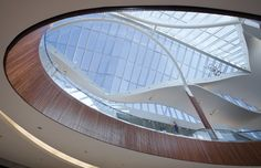 Boston's Natick Collection challenges the conventions of the regional mall Natick Mall, Ceiling Treatments, Shopping Malls, Atrium, Lighting Design, Skylights, Ceiling Lights, Bending, Mirror
