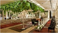 Could either have clusters of hanging ferns in ceiling insets...or a wall of hanging ferns behind the head-table