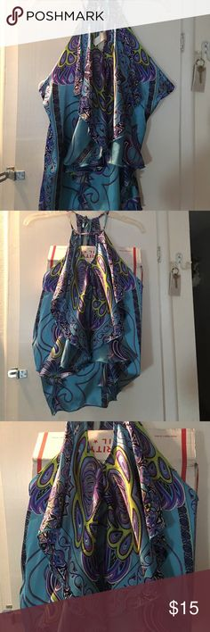 Silky blue halter style top By classique size med , mainly turquoise blue water purple and lime green , black and white . Very cute silk like material , ruffled front . classique Tops Camisoles
