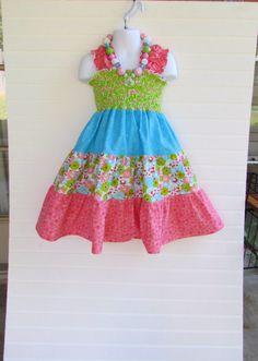 Girl's shirred sundress for summer! Pink, green, and blue floral dress