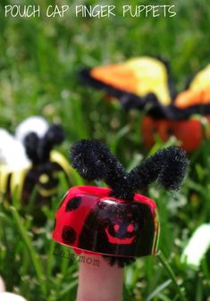 Make quick and easy bug finger puppets, a perfect spring craft for kids, using babyfood pouch caps and pipe cleaners!