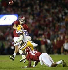 Alabama quarterback Jake Coker (14) passes the ball against LSU in the first half of an NCAA college football game Saturday, Nov. 7, 2015, in Tuscaloosa.