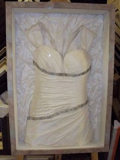 Frame your wedding dress! If you look closely, the back of the frame is the bottom part of the dress! Great for dressing room or walk in closet---I REALLY want to do this.