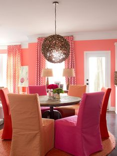 In the breakfast nook, tropical pinks and tangerines warm up the space without fighting with each other. And can we talk about that statement pendant light that anchors the room over the round pedestal table? Swoon! --> http://www.hgtv.com/design/decorating/design-101/how-to-decorate-an-open-floor-plan-pictures?soc=shpinparty