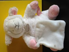 """Found on 25 Apr. 2016 @ Ransome Gardens, Edinburgh, EH4 7EU, UK. Help! My wee person dropped me in the road and my wee legs couldn't keep up. I am a very cuddly white """"Doudou et Compagnie de Paris"""" lamb and hold onto a wee blanket, which needs a wee wash. I am w... Visit: https://whiteboomerang.com/lostteddy/msg/ogw02f (Posted by Silke Trenz on 27 Apr. 2016)"""