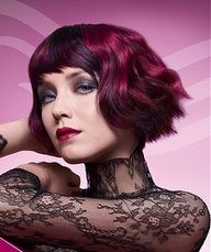 I love this so much! A short black wavy coloured multi-tonal purple choppy deep-red hairstyle by Wella