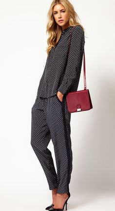 modern take on the suit.- Look how comfortable and efficient this suit is. The shoulder purse sets it off nicely.
