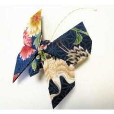 Discover easy and unique ideas for home, decor, beauty, food, kids etc. Try the best inspiration from a list of ideas which suits your requirement. Fabric Butterfly, Origami Butterfly, Fabric Flowers, Christmas Themes, Christmas Holidays, Christmas Decorations, Origami Christmas Ornament, Christmas Ornaments, Hawaiian Homes