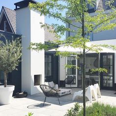 sun kissed patio with stylish furniture | adamchristopherdesign.co.uk