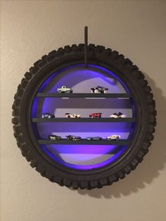 Dirt bike tire shelves with LEDs. Contact me if you are interested in purchasing one. Stefanie@ardor-innovations.com I also do custom peg boards and 3D printing http://amzn.to/2qUW7y8