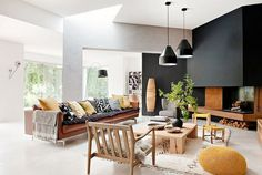 Open plan living room with pops of yellow