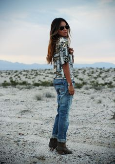 love her! sincerely jules in a silver sequin and glitter top, boyfriend jeans and booties!