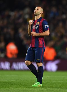 Javier Mascherano of Barcelona celebrates as Luis Suarez scores their second goal during the La Liga match between FC Barcelona and Real Madrid CF at Camp Nou on March 22, 2015 in Barcelona, Catalonia.