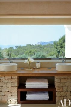 The master bath is outfitted with Duravit basins and Dornbracht sink fittings, and the counter is made of teak.