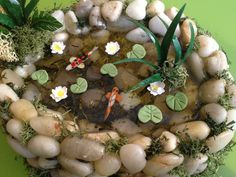 Koi Pond Dollhouse Miniature with koi fishes, water lilies, resin as a water and real stones for garden's dollhouse. €60.00, via Etsy.