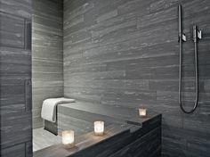 Grey bathroom inside the Rocksresort in Laax, Switzerland by Domenig Architekten _