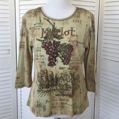 100% cotton graphic Cactus tee shirt Cute and comfy 100% cotton tee. Olive green and shades of beige and tan with burgundy print. Front is embellished with deep red crystals. Three quarter length sleeves, scoop neck. Worn and loved but still in great shape. No stains, holes, defects. Cactus Tops Tees - Long Sleeve