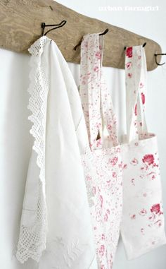 pretty linens on old hooks
