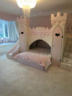 Luxury girls princess bedroom with handmade princess castle bed. Pink and cream farrow and ball paint finish , storage built in and a slide for extra fun.