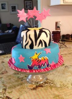 Made this jem and the holograms cake for my daughters 7th birthday