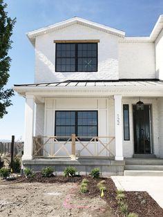 White brick, metal roof, black trim windows - studio McGee