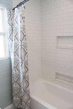white subway tile shower with niches