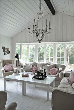 White hardwood floors and paneling. Living room