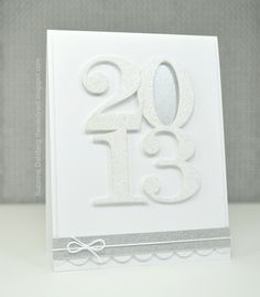 glittery white on white creates a classic handmade new years card the touches of silver washi tape and scalloped border help give dimension to the card