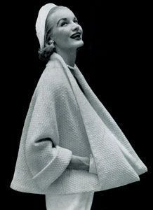 free vintage patterns - which is nifty, but this particular photo is a little weird. Is it just me or do her hands seem super long, or is she holding something. The jacket is still a neat swing coat.: