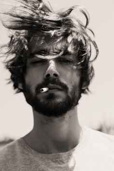 For some reason a guy with a cigarette hanging from his mouth always makes him significantly hotter....