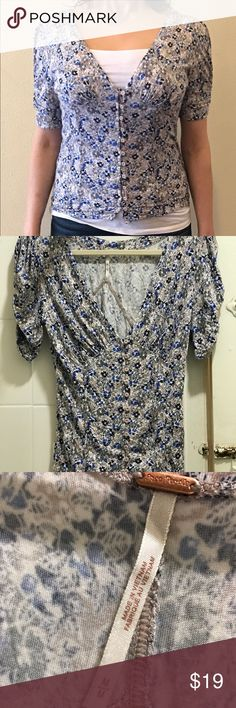Free People Floral Print Puffed Sleeve Shirt Gently used, worn and washed only once. I wore with white tank underneath since I wore it to work.   Shipping: within 24 hours  All of my clothes come from a clean, smoke free and pet free environment. Free People Tops Tees - Short Sleeve