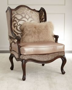 "Handcrafted wing chair. Mahogany frame. Cotton/viscose upholstered inside back; leather seat cushion; polyester outside back. 32""W x 38""D x 49""T. Seat, 22""W x 24""D x 20""T; arms, 27""T. Includes decorat"
