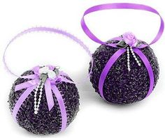 Lavender Pomander. This is not a tutorial but this picture give me ideas... starting with a Styrofoam ball perhaps.