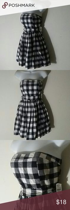 "NWT Black/White Flannel Strapless Dress, M Super cute strapless lightweight soft flannel dress in size medium. Brand new with tags attached. Waist sash that can tie in the back (like I have it) or in the front. Dress is about 27"" top to bottom and fits true to size. Miss Avenue Dresses Mini"