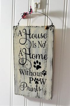 Paw print wooden sign saying for those animal lovers, A house is not a home without paw prints, Rust