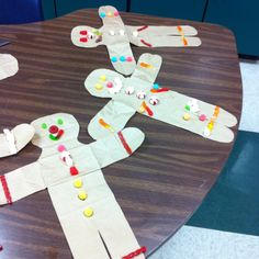 Gingerbread man made from paper bags & decorated with candy! You can use same template to make scarecrow for fall.