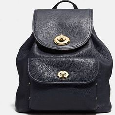 The Coach Mini Turnlock Rucksack 37581 Black Pebbled Leather Backpack is a top 10 member favorite on Tradesy. Coach Backpack, Rucksack Backpack, Leather Backpack, Backpack Handbags, Leather Bag, Coach Handbags, Coach Purses, Coach Bags Outlet, Gold Backpacks