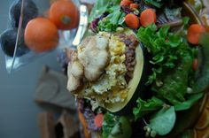 Baked squash stuffed with lentils, rice, eggs and our homegrown Lions Mane and Oyster Mushrooms on a bed of salad mixed with kiwi and carrot...