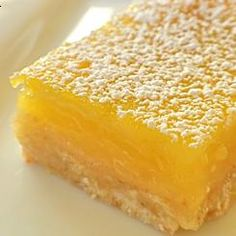 Lemon Squares Recipe served at Crystal Palace in Magic Kingdom at Disney World - A popular bar cookie dessert made with a cookie crust and lemony topping. Lemon Desserts, Lemon Recipes, Just Desserts, Sweet Recipes, Delicious Desserts, Dessert Recipes, Yummy Food, Disney Desserts, Disney Food