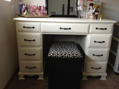Here's the makeup vanity I made a couple of weekends ago. I bought an old desk from Craigslist for $30, a can of paint for $7, and A TON of sanding!