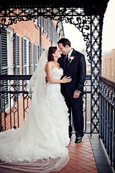 Such a romantic photo of this couple on our wrought iron balcony at Royal Sonesta Hotel New Orleans.