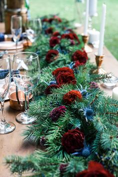 Winter Wedding Styled Shoot | evergreen garland with blue thistle, David Austin Tess deep red garden roses, red ranunculus, navy and copper accents | Calligraphy by: Inkwell, Columbus, Ohio | Photography: Evergreen Flower Co.
