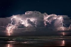 Positive lightning shoots out of the top of a thunderstorm off the coast of Ormond Beach, Florida