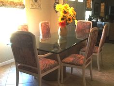 Beautiful large beveled glass dinning table with 4 side chairs and 2 captain chairs in grandtable's Garage Sale in Ramona , CA for $100.00. Beautiful large beveled glass dinning table with 4 side chairs and 2 captain chairs. Chairs are bleached white,solid hard wood and fabric covering is in great condition. Table tob is very thick and sits on two round pedestals.