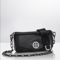 """TORY BURCH Classic Bag Lovely little silhouette fashioned from genuine leather, finished with signature hardware detail and logo emblem. Chain and leather shoulder strap, 22"""" drop. Magnetic snap flap closure. Gunmetal hardware. Exclusive edition- no longer sold in stores with gunmetal chain and hardware. Great condition- only used a couple times. 7"""" wide by 3 3/4"""" tall. Tory Burch Bags"""