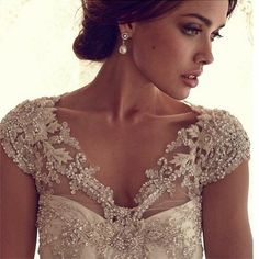 The make-up, the up-do, the neckline detail of the dress and the earrings all make this look perfect for an event where you want to stop traffic (not just a wedding).